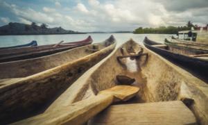 Wooden canoes. Credit: hanohiki / Adobe Stock