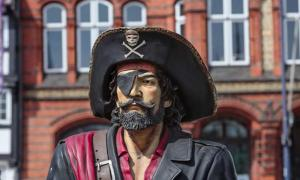 Statue of pirate with eyepatch.