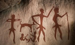 Reproduction of a prehistoric cave painting showing hominins hunting