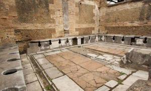 Ruin of a second-century public toilet in Roman Ostia.
