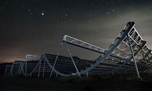 The CHIME telescope looking up at the night sky. The Canadian telescope has captured new bizarre radio signals from 1.5 billion light years away.