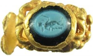 The ring was carved in nicolo, a type of onyx, and set in gold.