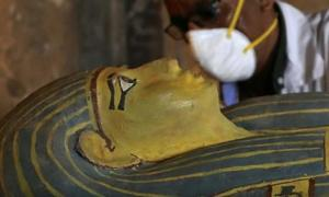 Sarcophagus of Egyptian woman opened at press conference.