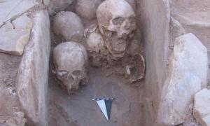 A set of skulls found buried in a stone cist inside a prehistoric house at Shkārat Msaied in Jordan.