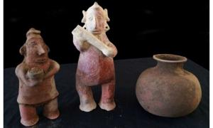 Figurines discovered in recently-unearthed tomb in Mexico.
