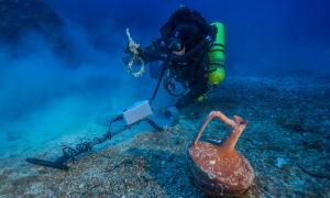 Metal detector survey of the shipwreck area, photo by Brett Seymour.