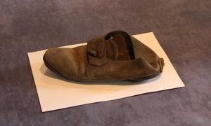 This 300-year-old shoe was discovered behind a wall at St John's College and is thought to have been an amulet meant to ward off evil. (St. John's College photo)