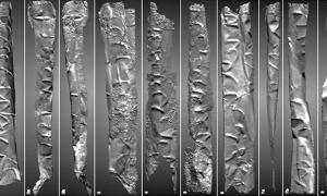 This silver scroll, revealed digitally by a group of researchers, may be an incantation of an 8th century magician in Jordan. The language is unknown, but the practice of placing magical incantations on scrolls and placing them in containers is well known from antiquity.