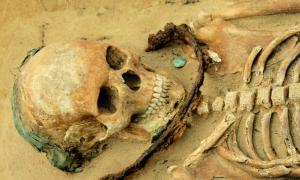 A girl age 14 to 19 was buried with a sickle across her throat, a copper headband and a coin near her mouth; the authors of a new study said her community may have thought she had demonic tendencies.