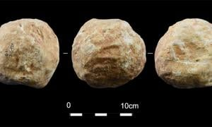 Stone balls, aka petrospheres were found at Qesem cave, Israel.        Source: Assaf et al 2020