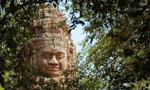 Monumental stone face at Bayon Temple, Cambodia.