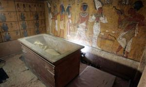 The stone sarcophagus containing the mummy of King Tut is seen in his underground tomb.