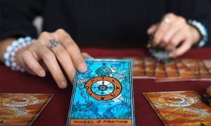 Tarot card reading. Credit: Benjavisa Ruangvaree / Adobe Stock