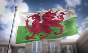 Wales Flag on Blue Sky.