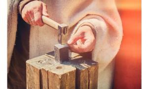 traditional craftsman creates silver money