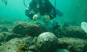 The underwater archaeologists found dozens of cannonballs at the wreck site.