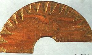 Wooden fragment discovered in Uunartoq, Greenland, in 1948, which is believed to be a sun-compass used to determine direction
