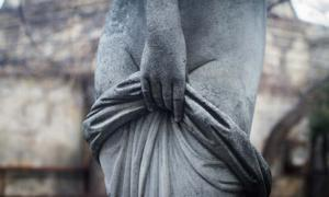 Statue of a woman covering herself. Credit: macondos / Adobe Stock
