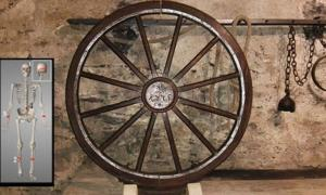 Wheel of Torture device. Insert, skeleton of young man wh9 was the victim of torture on the wheel.