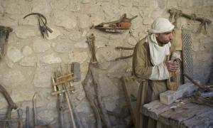 Ancient carpenter, woodworking. Source: deanjs / Public Domain.