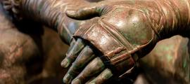 Details of an ancient Roman bronze statue. Credit: giorgio / Adobe Stock