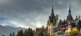 A photo of Peleș Castle in autumn.