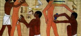 Ancient Egyptian men undergoing circumcision.