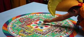 A Buddhist monk creating a mandala