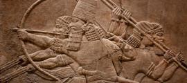 Mesopotamian relief of Assyrian warriors. Credit: kmiragaya / Adobe Stock