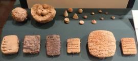Clay accounting ball with calculi, counters, and evolution of cuneiform. Exhibit in the Oriental Institute Museum, University of Chicago, Chicago, Illinois, USA