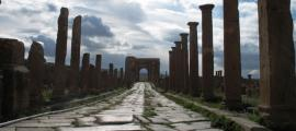 Roman Ruins of Timgad (Wilaya of Batna, Algeria). Street leading to the Arch of Trajan.