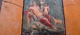 The brightly colored Narcissus painting recently recovered in Pompeii.