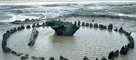 Seahenge – how it was found at low tide off the coast of Norfolk, England.     Source: Norfolk Archaeology Unit