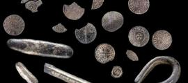The treasure found by a Welshman with a metal detector includes silver pennies and coin fragments from the time of King Cnut of England and Scandinavia.