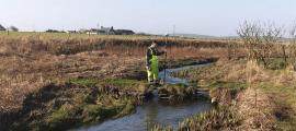 Top image: The Orkney River is part of the recently discovered Orkney Viking waterway. The researcher shown in this photo is carrying remote-sensing geophysical mapping equipment.           Source: Express and Star