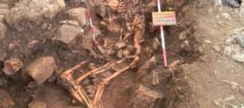 A rare ancient Greek gravesite containing two intertwined corpses