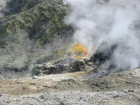 Sulfur drifts from a vent on the barren volcanic plateau