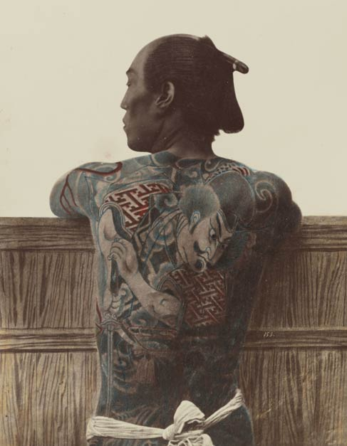 A tattooed man's back, c. 1875