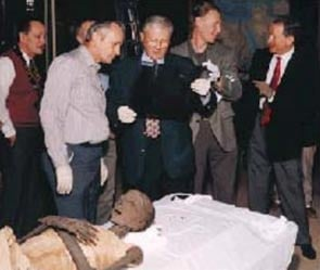 A team of experts, including (from left) BYU professor C. Wilfred Griggs, Utah county medical doctors Bruce Mcliff and Richard Jackson, and San Jose, Calif., doctor Grady Jeeter, examines the mummy in which Griggs discovered a 9-inch iron knee pin. Courtesy of Rosicrucian Egyptian Museum.