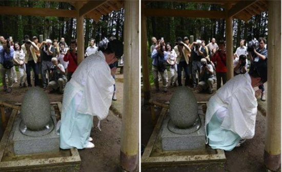 Temple priest Osamu Hayakawa demonstrates the healing ritual