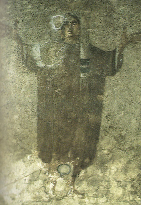 Image of 'the veiled woman' in the Santa Priscilla catacombs.