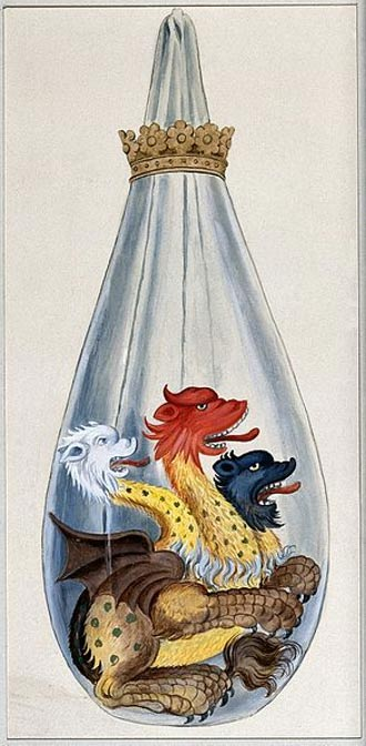 A three headed monster in an alchemical flask, representing the composition of the alchemical philosopher's stone: salt, sulphur, and mercury.