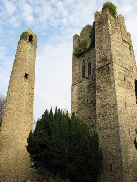 The round tower and a former 14th century abbey church tower in Swords, Co. Dublin, Ireland. (Peter Gerken/CC BY SA 2.0)