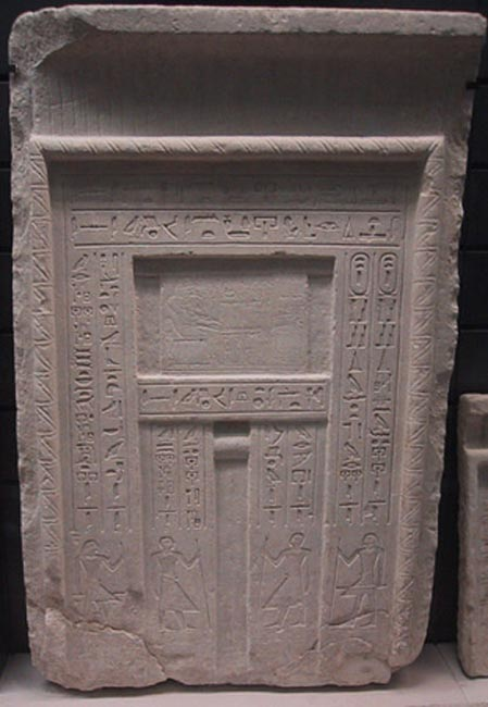 A typical false door to an Egyptian tomb - the deceased is shown above the central niche in front of a table of offerings, and inscriptions listing offerings for the deceased are carved along the side panels. (CC BY SA 3.0)