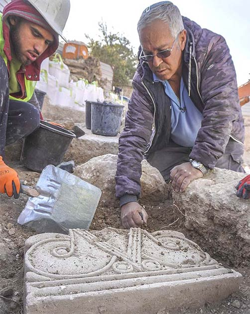 The uncovering of the capitals as they were found in the ground at the Jerusalem excavation site. (Shai Halevi / Israel Antiquities Authority)